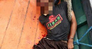 Pelaku yang behasil ditangkap polisi ini  menggunakan kaoe bertuliskan Jihad (istimewa)